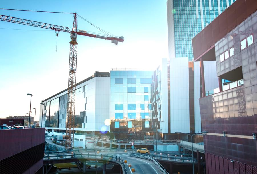 Construction surrounded by large buildings